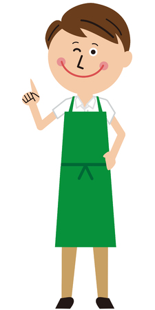 A guy wearing a green apron poses pointing