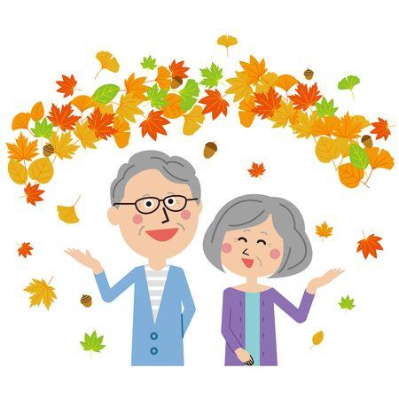 Pop senior couple enjoying the autumn leaves
