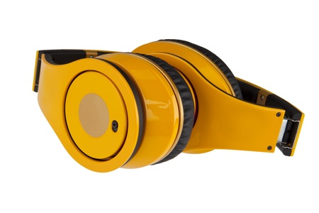 Yellow headphones on white background photo
