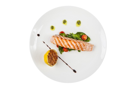 Grilled salmon steak with herbs and photo