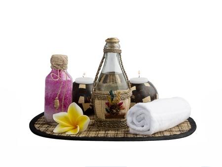 Fondo de Spa con sales de baño, una toalla y una vela