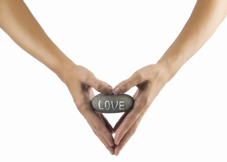 isoleted: love rock in hands isoleted on white