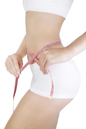 허리의 잘룩 한 선: Woman measuring her waistline  Diet  Perfect Slim Body  스톡 사진