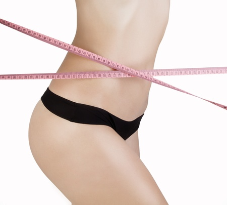 Woman measuring her waistline  Diet  Perfect Slim Body  photo
