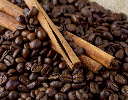 coffee beans and cinnamon sticks photo