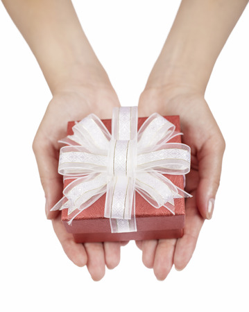 Female hands holding small gift with ribbon
