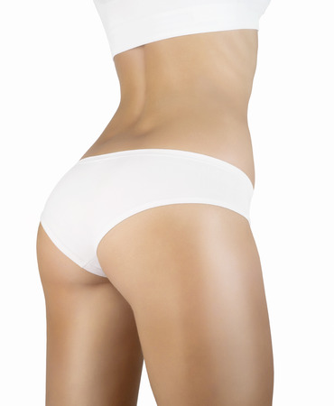 Side view of the naked female body in panties photo