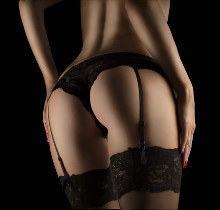 nude female: PERFECT female SEXY BUTTOCKS IN BLACK LINGERIE on black background