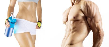 fitness hombres: Bodybuilding Hombre fuerte y una mujer posando aislados sobre fondo blanco Foto de archivo