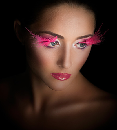 Fashion Model Portrait. Professional Makeup. False Eyelashes. Make-up photo