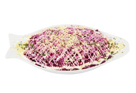 Russian traditional herring salad with beetroot, carrot, eggs on white pllate. Bread and cutlets photo