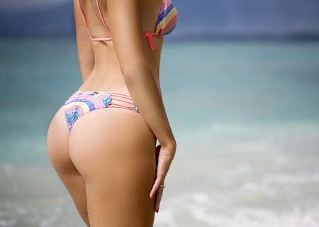 nude ass: Sexy sandy woman buttocks on the beach background