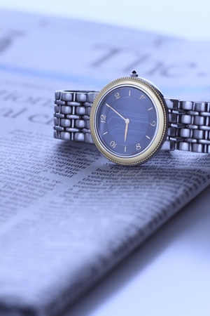 wrist  watch over newspaper photo