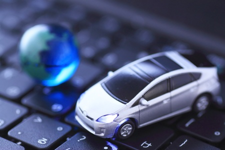 mpg: Glass globe and    prius over keyboard