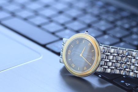 a wrist watchover keyboard Stock Photo