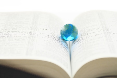 Glass globe   over book