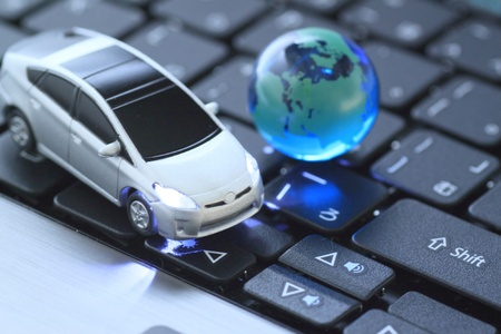 Glass globe and prius  over keyboard