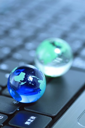 Glass globe over keyboard photo