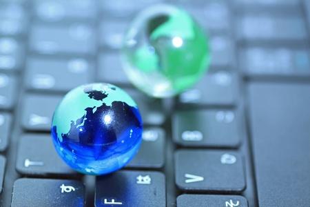 Glass globe over keyboard photo
