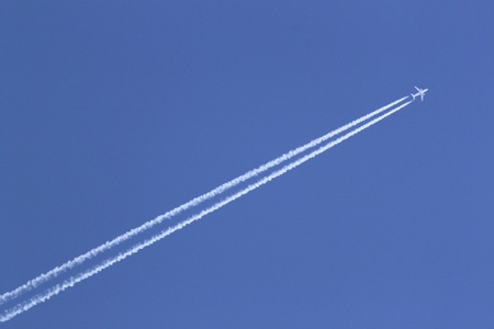 contrail in blue sky photo