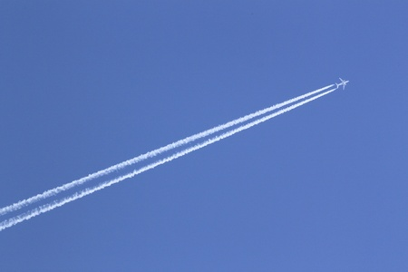 airfoil: contrail in blue sky