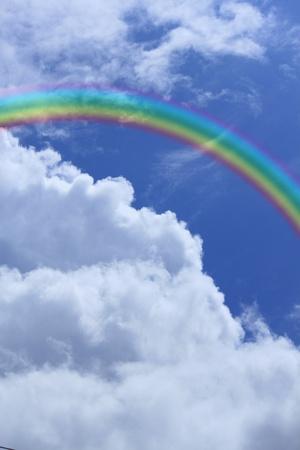 rainbow against blue sky photo