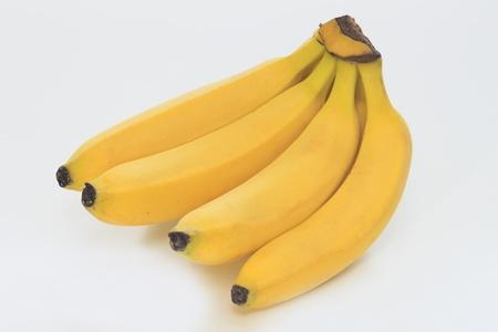 白い背景の上の甘いバナナ