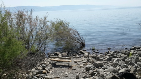 galilee: Bench on Sea of Galilee lake, Israel Stock Photo