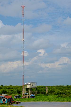 telephone pole: High telephone pole under blue sky around Tonlesap, Cambodia Stock Photo