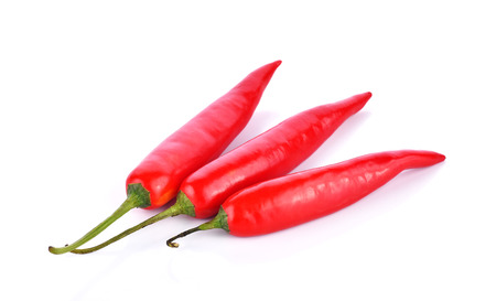 capsaicin: Red chilli peppers on white background
