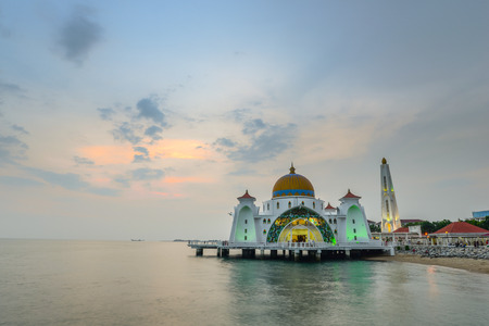 islamic scenery: Melaka mosque in the evening and twilight time ,This mosque locate on the beach in melaka city and melaka straits ,Malaysia