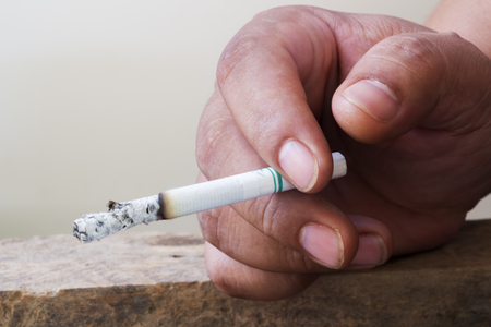 pitfall: Smoking for disease and death. Stock Photo