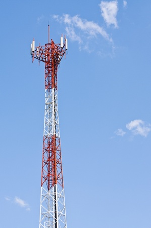 Mobile phone signal post on blue sky background  photo