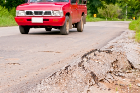 cracked road and red car Stock Photo - 13946724