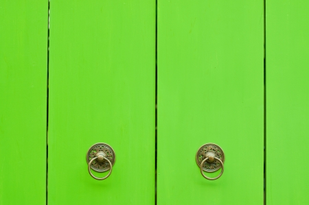 brass knocker on the green door Stock Photo - 14070242