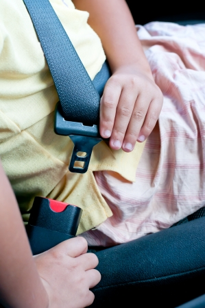 3642;Boy sit on car seat and fasten safety belt  Stock Photo