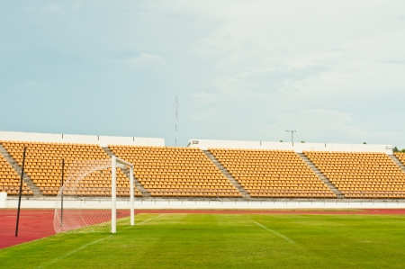 Football field with empty bleachers in the background   photo