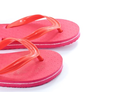 Red beach shoes isolated on white background photo