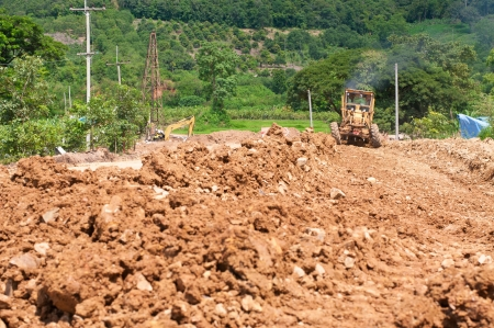 grader leveling the under construction road Stock Photo - 15234593