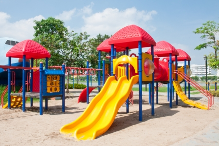 Modern children playground in park Stock Photo