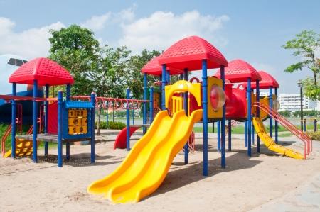 Modern children playground in park Standard-Bild