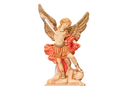 Statue of the archangel Michael trampling Satan on a white background  photo