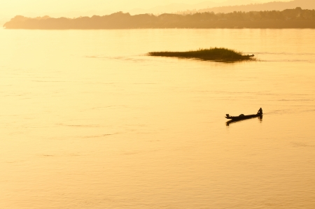 The man fishing in a field in the flood season, the Mekong River ,Chiang Khan, Thailand Stock Photo - 15931585