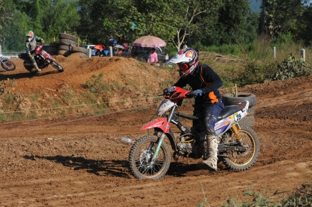 panning shot: CHIANGKHAN, THAILAND - OCTOBER 28: Unidentified riders participate in competition Supercross Championship of Thailand, on October 28, 2012 in Chiangkhan,Loei,Thailand