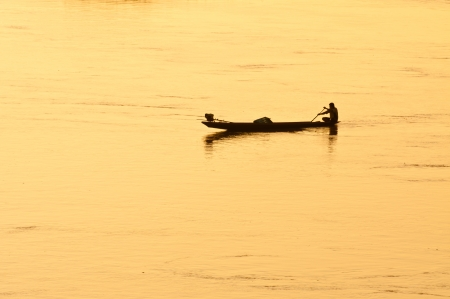 The man fishing in a field in the flood season, the Mekong River ,Chiang Khan, Thailand  photo