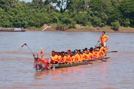 watersport: CHIANGKHAN,THAILAND - OCTOBER 29:Unidentified crew in traditional Thai long boats compete during Queen Cup Traditional Long Boat Race Championship on October 29, 2012 in Chiangkhan, Loei,Thailand.