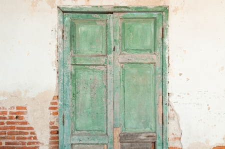 Old door in a crumbling building  photo