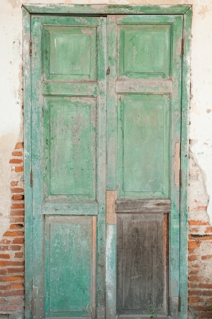 residential idyll: Old door in a crumbling building  Stock Photo