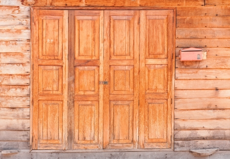 Old wooden house door, Thailand traditional style  photo