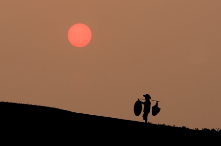 people carrying things as silhouette background  Stock Photo